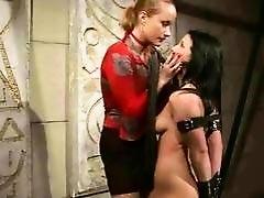 Fashionable mistress painfully punishing her slavegirl