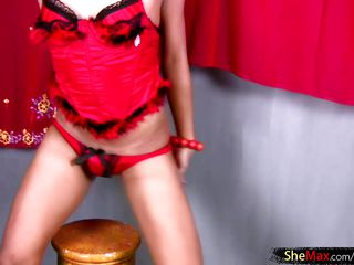thai tgirl is dancing in colorful clothing ahead of jerking off
