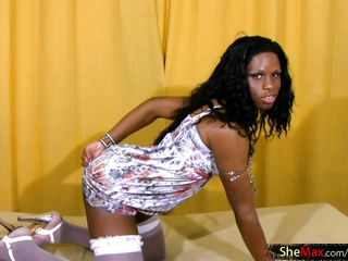 black haired shedoll plays with her largest arse and black cock
