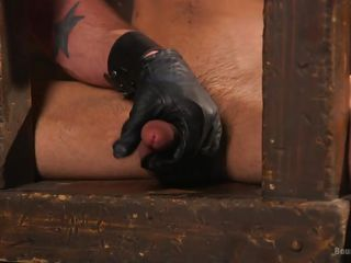 bound gay slave fully erect while in torment
