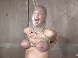 busty blonde slave is tied up and uncomfortable